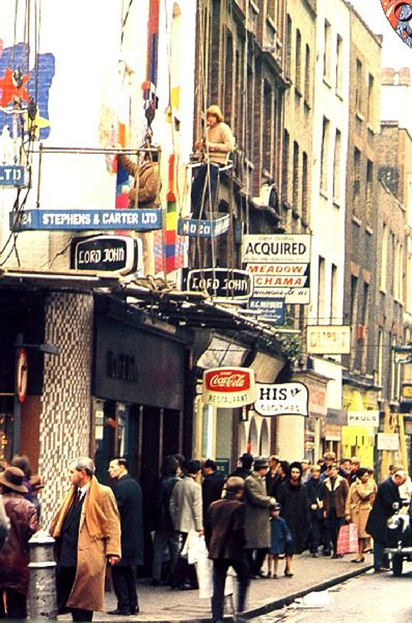 The facade of Lord John in Carnaby Street being painted.