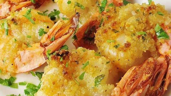 BAKED SHRIMP SCAMPI - Tender shrimp are tossed with butter, garlic, and lemon juice and baked with Italian-seasoned bread crumbs in this rich and flavorful dish.