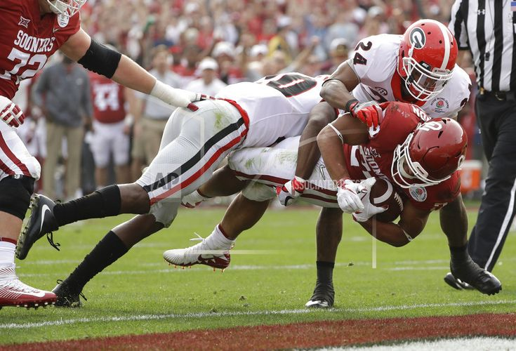 January 01, 2018(AP)(STL.News) — The Latest on the College Football Playoff semifinals (all times EST): 6:02 p.m. Moments after Rodney Anderson put Oklahoma up 21-7 with a 41-yard touchdown run, Georgia responded with a 75-yard run by Sony Michel. One minute into the second quarter and the Rose B... Read More Details: https://www.stl.news/latest-michel-75-yard-run-puts-georgia-within-21-14/59683/