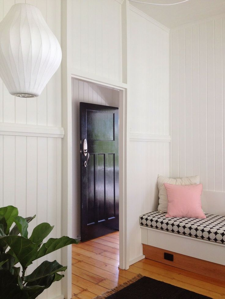 Glossy black front door! Love the style of the inside too…