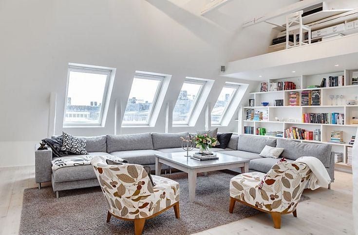 Living Room. Cozy Attic with White Interior Declaring a Comfortable Living Home: Inspiring White Colour Attic Living Room Ideas With Vintage Patterned Leaves Sofa And Gray Sectional Sofa Ideas Featuring Wall Bookshelf ~ wegli