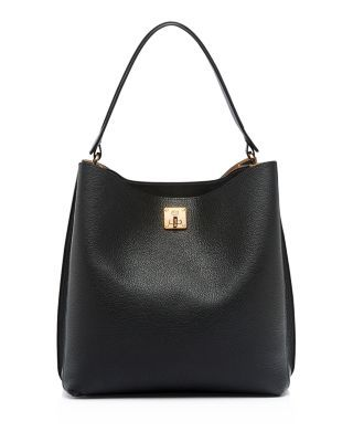 Gilded turnlock hardware adorns Mcm's minimalist yet luxurious tumbled leather hobo which features a roomy, well-organized interior and optional shoulder strap.   Leather   Imported   Top handle, deta