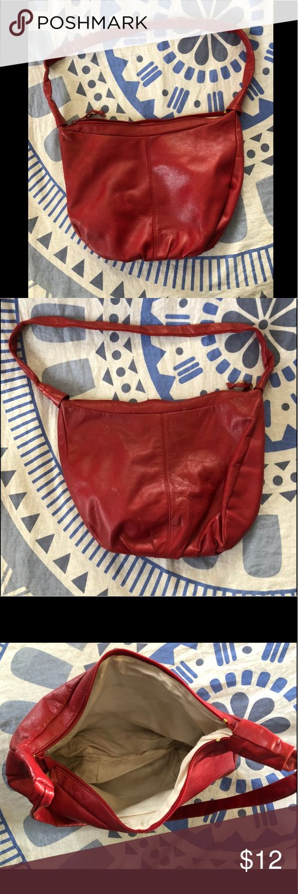 Red Hobo Shoulder Bag Red Hobo Shoulder Bag with interior zippered pocket.  This is a used purse and does show signs of I Love This Purse!!! such as loose trim on outside pocket, some loose strings, scuffs, scratches, wearing and stains. Please review all photos 😀  COMES FROM A DOG AND SMOKE FRIENDLY HOME. Bags Hobos