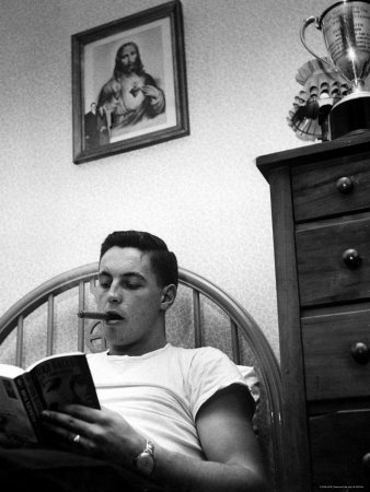 Ice Hockey Player Jean Beliveau, Cigar in Mouth, Reading a Book in His Bed. art.com