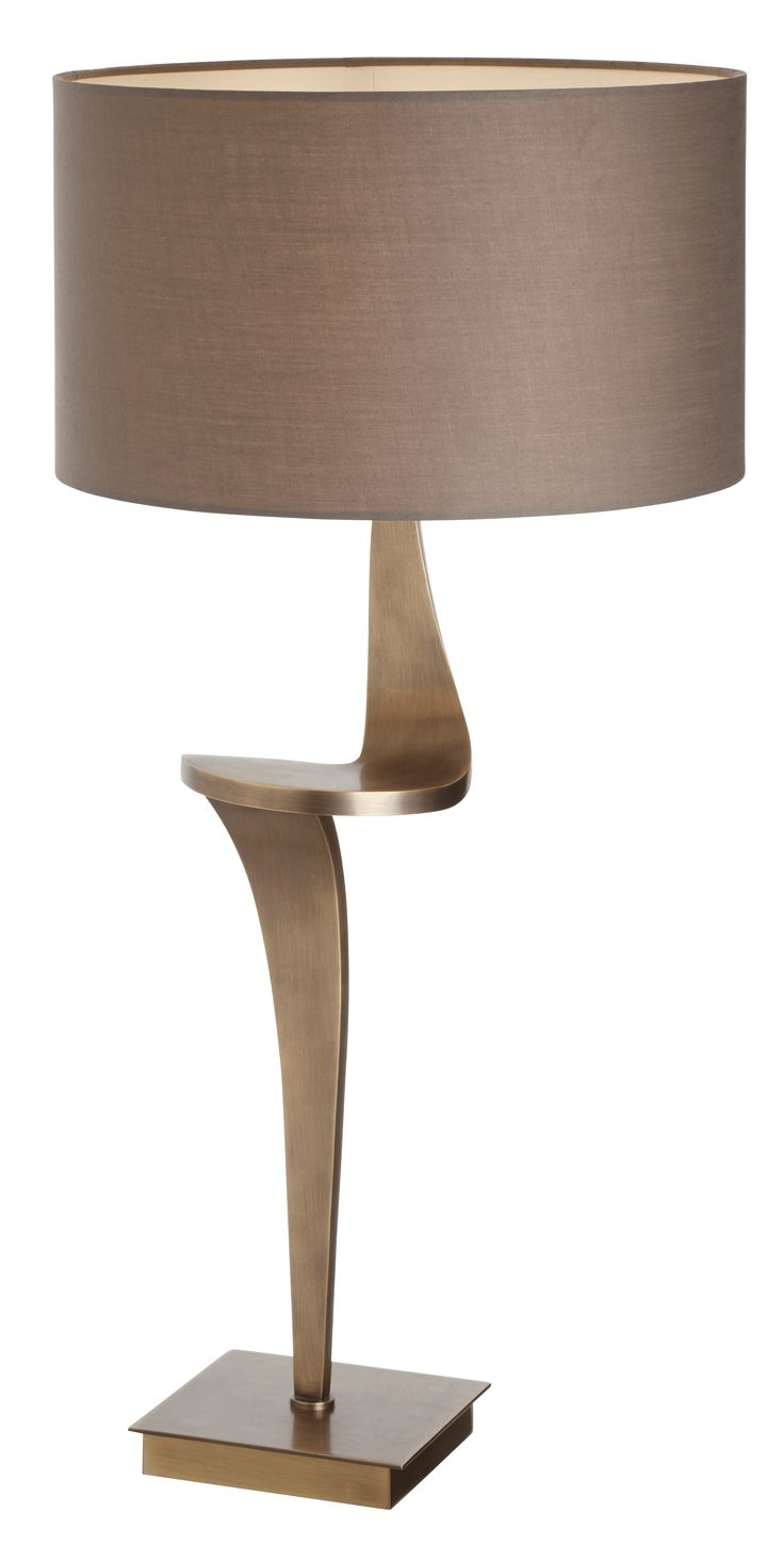 The Enzo Antique brass table lamp by RV Astley boasts a frame finish in antique brass, with a brown light shade. Part of the Enzo range, this beautiful floor lamp is the perfect compliment to a minimalist living room.