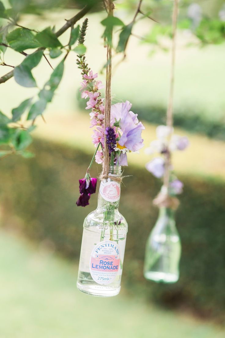 Bottles filled with Flowers Hanging From the Trees | Scampston Hall Yorkshire | Outdoor Ceremony | Marquee Reception | Samantha Ward Photography | http://www.rockmywedding.co.uk/bianca-sam/