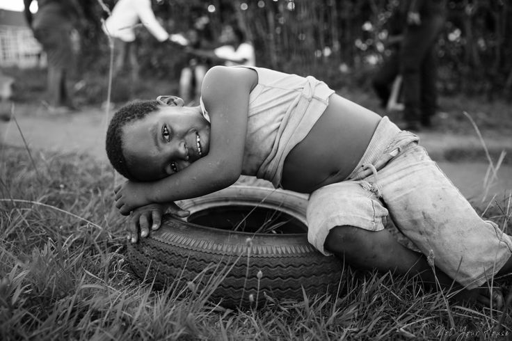I've got my tyre, I'm good.  Photo taken in Mphophomeni, KZN. This little guy was so chuffed to show off his tyre. Absolutely in love with the people of South Africa. So lucky to call it home.  |Tags|  Black and white photography, South Africa, Canon, Photography, Culture, Authentic