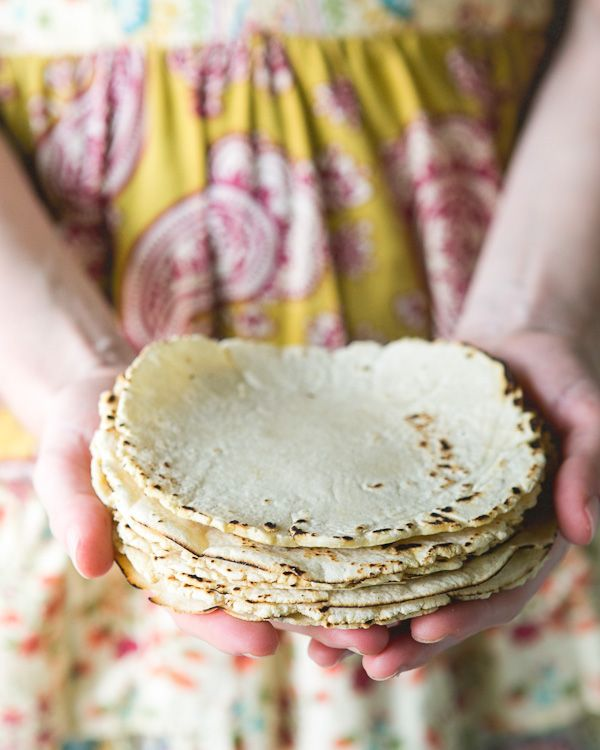 Homemade Corn Tortillas  What You Need  2 cups yellow masa harina  ½ teaspoon kosher salt  ½ tablespoon olive oil  1 ½ cups warm water  Skillet (cast-iron, if possible)  Tortilla press or a pie plate  Plastic bag or wax paper