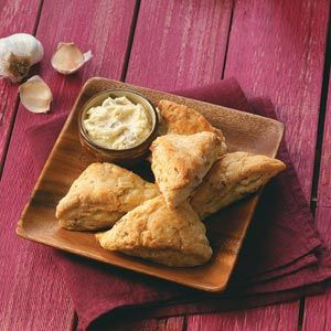 """Savory Cocktail Scones Recipe -""""Scones are comfort food to me, and I wanted to make  a savory version with roasted garlic butter. The addition  of bacon seemed natural. Their cocktail size makes them fun; they also work for a brunch buffet.""""—Donna Marie Ryan, Topsfield, Massachusetts"""