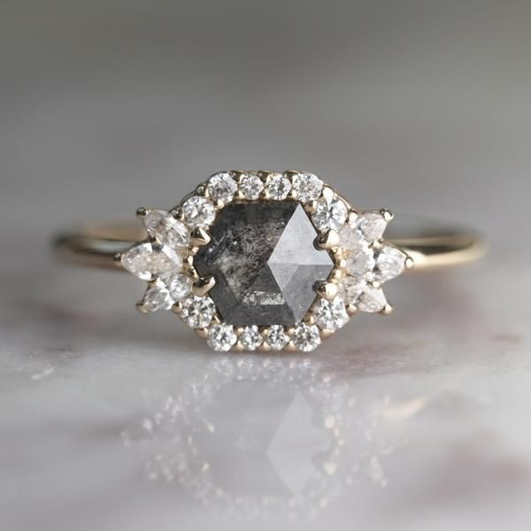 78c348bcc946c Hexagon Cleo Halo Engagement Ring This ring features a beautiful ...