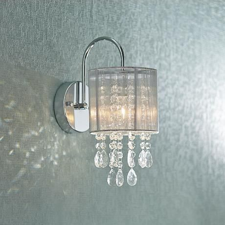 Dazzling modern decor at its finest, this beautiful wall sconce features a distinctive shade and glistening crystal is from the Possini Euro Design collection of lighting.