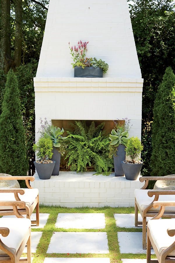 This organic look comes from pairing the strong lines of a modern container with soft and natural plants. The handsome metal planter on the mantel has a slatelike finish and blends various succulents with the pink plumes of 'Joey' ptilotus. Large-leaved kalanchoes and dwarf golden arborvitaes form the base of this masterpiece, which can grace a mantel or the center of a backyard dining table.