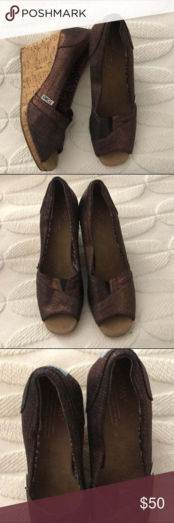 Toms metallic Wednesday Size 7.5 new Toms peep toe metallic wedges - size 7.5 - never worn (no sticker or box though) TOMS Shoes Wedges