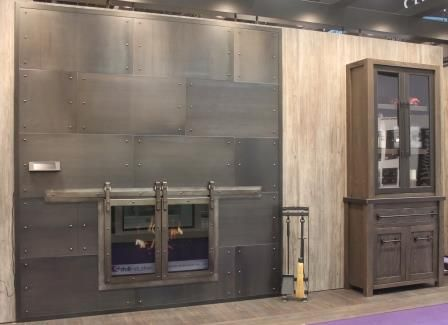 Bring the sliding barn door look to your fireplace with these glass doors.  Continue the farmhouse theme with custom wall panels, a non-combustible mantel and fireplace tool set.