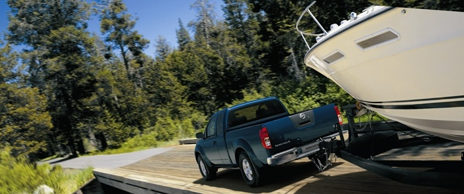A capable workhorse, the Nissan Navara towing a large boat.