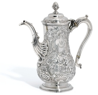 A GEORGE II IRISH SILVER COFFEE-POT  MARK OF WILLIAM TOWNSEND, DUBLIN, CIRCA 1750  Pear-shaped and spreading reeded foot, with fluted and leaf spout, the body decorated overall with panels of Chinese figures in landscapes surrounded by foliage scrolls and flowers, engraved with coat-of-arms, the domed cover with a pineapple finial, with Victorian silver handle, marked near rim, on cover bezel and on handle   11 in. high  gross weight 36 oz.