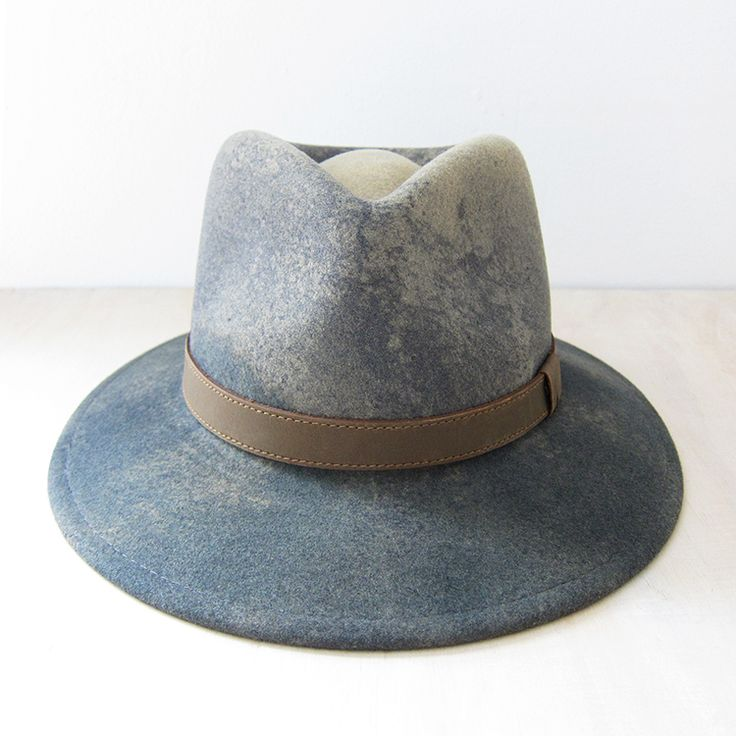 This outdoorsman inspired style is trimmed with a simple leather band and then taken to the next level with a hand dipped ombre dye technique. Each hat is individually hand crafted and unique.