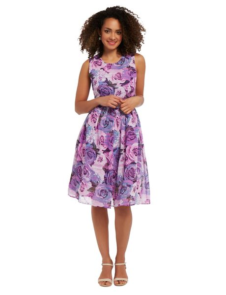 This pretty floral printed dress is a midi length and has princess panels on the front body. It has a flattering waist seam while the skirt is pleated. This dress is fully lined.