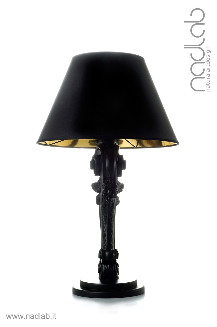 Bucefalo limited neropaco (light OFF)  The base and the body of the lamp in wood are hand-carved.  The lampshade is made of PVC and coated in black chinette.  Decorated in matt black.  customizable on request.