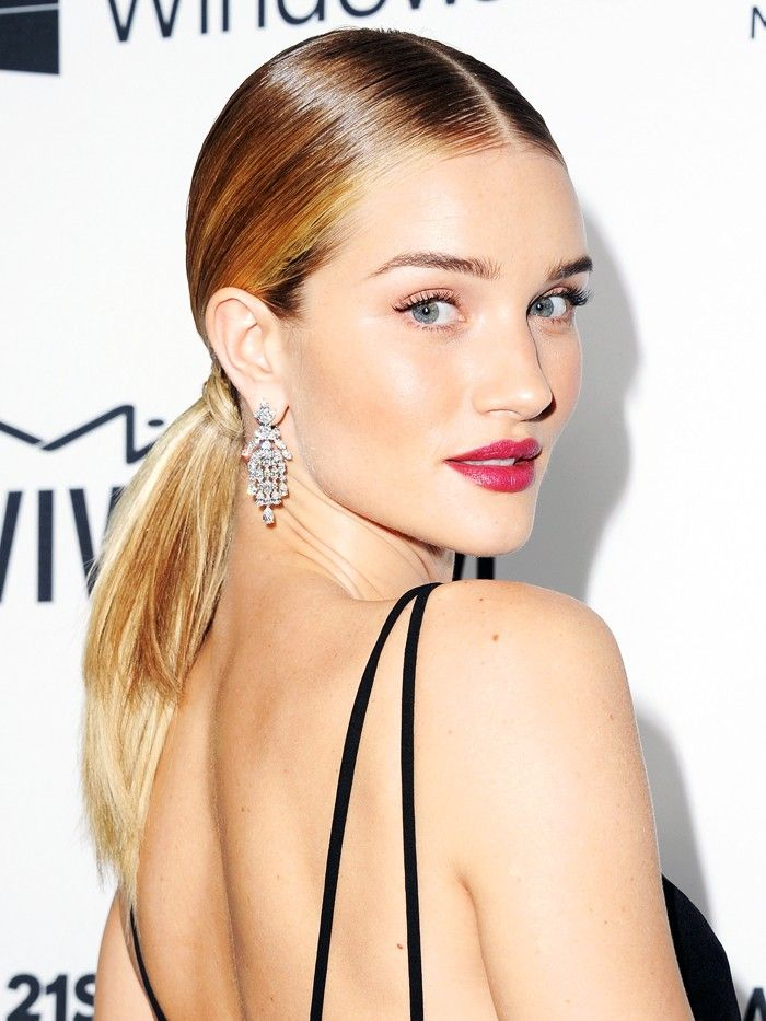 Rosie Huntington-Whiteley smolders with a sleek ponytail and a berry-stained lip