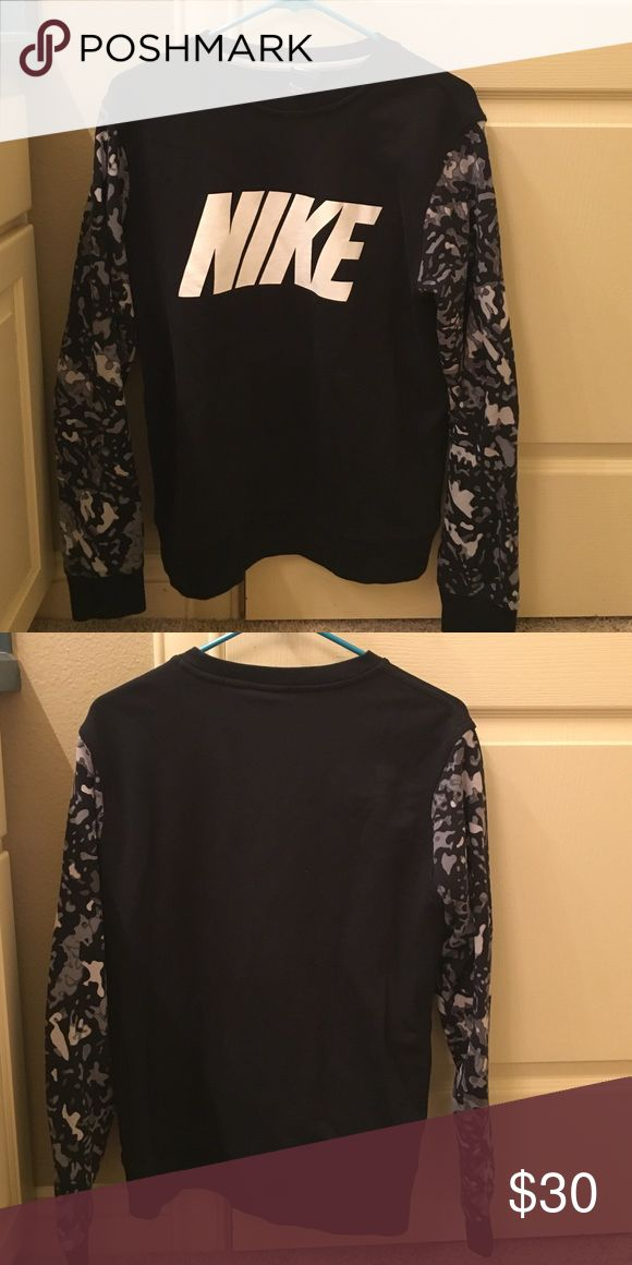 Nike black & gray camouflage sweatshirt Like new men's Nike sweatshirt. It's a men's medium, but I am usually a women's medium and this fits comfortably, but not too baggy. It's a warm sweatshirt, but the inside is more of a soft cotton and not fleece. Nike Shirts Sweatshirts & Hoodies