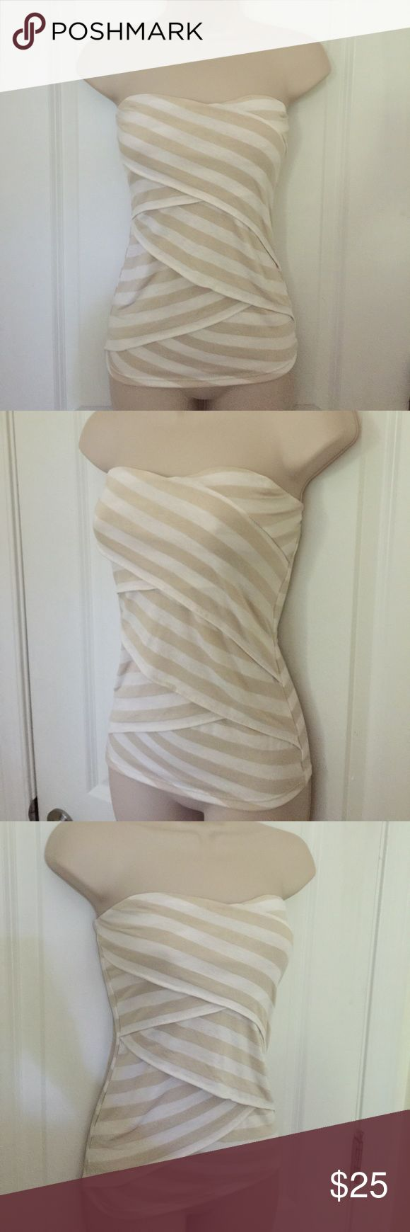"""WHBM Beige/white striped knit bandeau top sz XS Beige & white striped tiered bandeau top from WHITE HOUSE BLACK MARKET  Size EXTRA SMALL Bust (underarm to underarm) - UNSTRETCHED: 30""""  Bust (underarm to underarm) - STRETCHED: up to 36""""  Length (underarm to hem): 16""""  Stretch bandeau top with striped pattern. Tiered at front.  Shell: 48% polyester, 47% rayon, 5% spandex. Lining: 94% polyester, 6% spandex.  In excellent gently used condition. No stains, tears or holes. From a smoke free home…"""