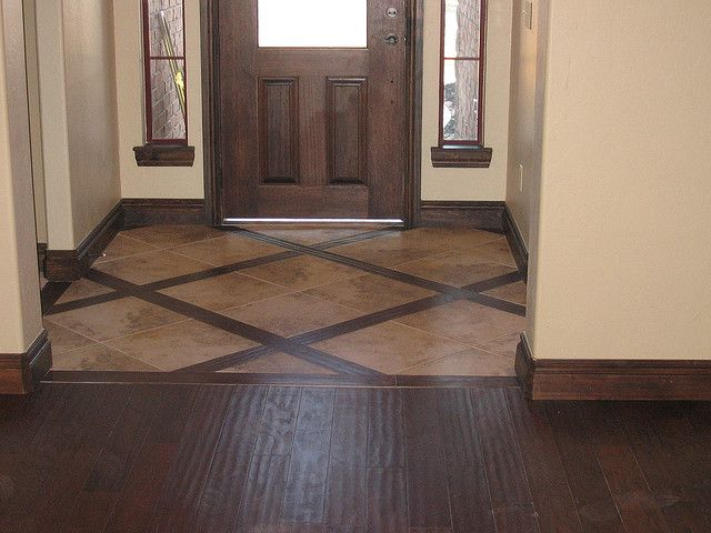 Cool entry floor- combination wood and large tile *M* >>>> This is what I  want! The tile/wood combo in the entryway and then the matching hardwood in  the ... - 25+ Best Ideas About Tile Floor Designs On Pinterest Flooring