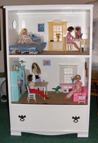 DIY Barbie doll house out of an old dresser with a drawer for storage at the bottom