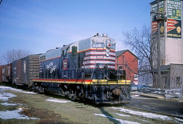 """marmarinou: """" CB&Q GP7 226 by Chuck Zeiler on Flickr. Caption: """"Chicago Burlington & Quincy Railroad GP7 226 on the East End Way Freight at Naperville, Illinois on April 1, 1964, Kodachrome by Chuck Zeiler. Built in September 1951 (c/n 14690) on EMD..."""