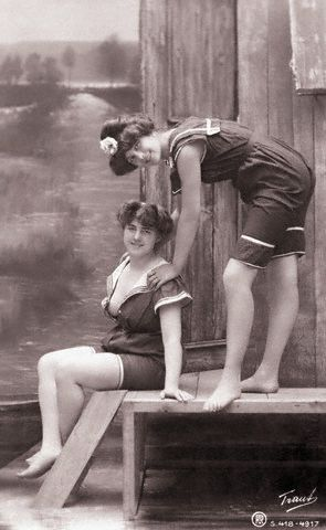 1890's studio portraits of two young women posing in bathing suits