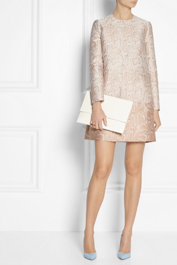 STELLA MCCARTNEY Python-jacquard dress $1,460 Stella McCartney's python-jacquard dress is a toned-down take on the season's animal prints. This universally flattering style has a loosely tailored, slight A-line shape. Make a statement by pairing yours with the matching coat.  Shown here with: Arme De L'Amour ring, Esteban Cortazar ring, Gianvito Rossi shoes, Stella McCartney clutch.