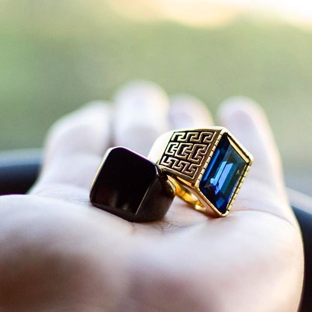 @andrews.v_ showing off his favorite rings from our collection. Our platinum gold plated ring with blue crystal stone combined with our jet black titanium ring will sure be a great addition to your accessories. Visit our site today to see our entire range.