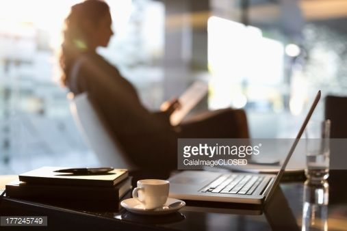 Stock Photo : Businesswoman using digital tablet in lobby