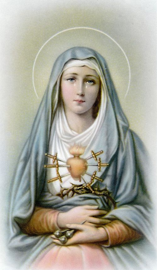 This laminated holy card has an image of Mary with a pierced heart on the front and the following prayer on the back:  The Seven Sorrows