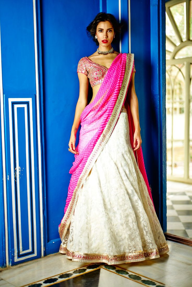 A virginal white embroidered Lehenga, created for the special bride. The pink choli, again crafted with care in gota patti along with the thoughtfully teamed leheriya dupatta makes it a young and contemporary ensemble.