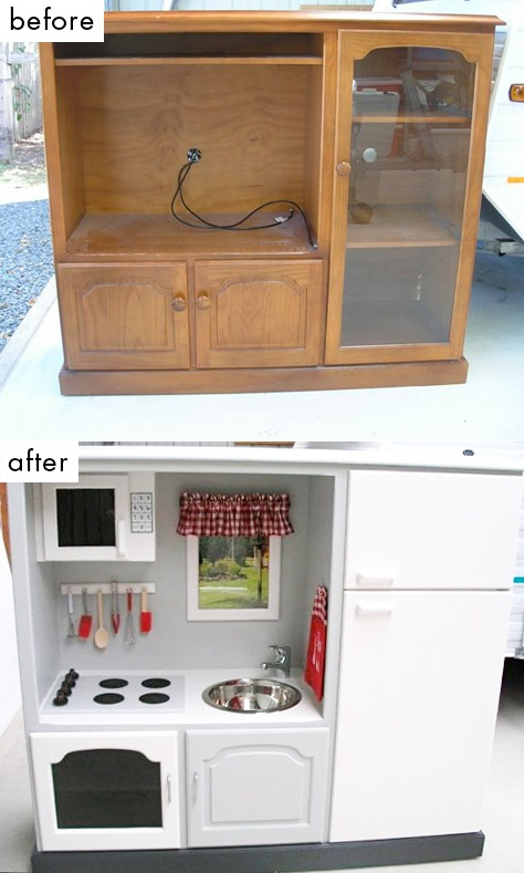 This is the best!   An old entertainment center becomes a kitchen with fridge, stove, sink, microwave, even a little window and a utensil rack