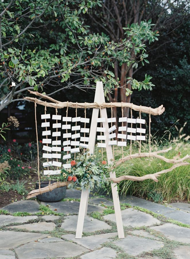 Rustic wood escort card display: http://www.stylemepretty.com/2016/04/07/intimate-outdoor-wedding-filled-with-cultural-meaning/   Photography: Judy Pak - http://www.judypak.com/