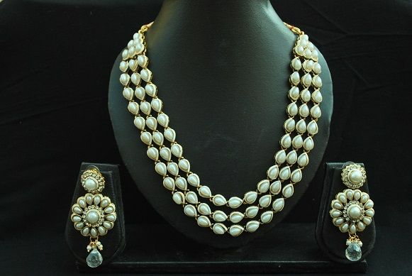 Reeti Fashions - Elegant Pearl Necklace with Round Pearl Earrings. This copper jewelry studded with pearl is perfect for any of your traditional & festive wear.