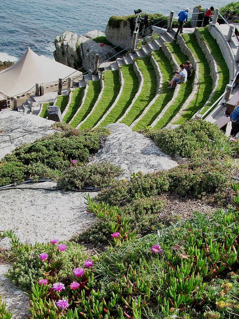 Minack Theatre, Porthcurno, Cornwall, England. An old open-aired theatre constructed on a large granite rock that reaches out into the ocean. Today, the theater is still fully function and runs 17 plays during the summer season.