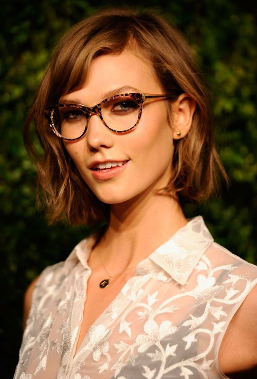 Karlie Kloss looks like a kitten that is up to no good.