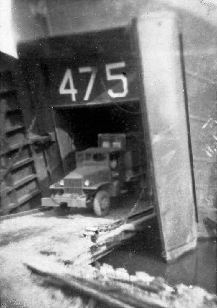US Army CCKW 2 1/2-ton 6x6 cargo truck carrying airfield support supplies exiting USS LST-475 beached at Yokohama, Japan, 13 Sep 1945; the ship was the first LST landing in Japan after surrender