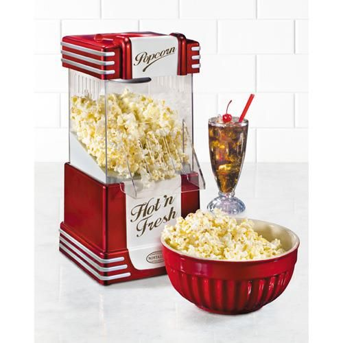 Nostalgia - Retro Hot Air Popcorn Popper - The Nostalgia RHP-625 Retro Popcorn Maker is a plastic replica of the old-fashioned, diner-style units of the 1950s. This convenient, tabletop-size electric popper uses hot air instead of oil, producing a deliciously healthy, low-fat snack. An included measuring cap assures the proper amount of kernels are poured into the top before the unit is turned on.