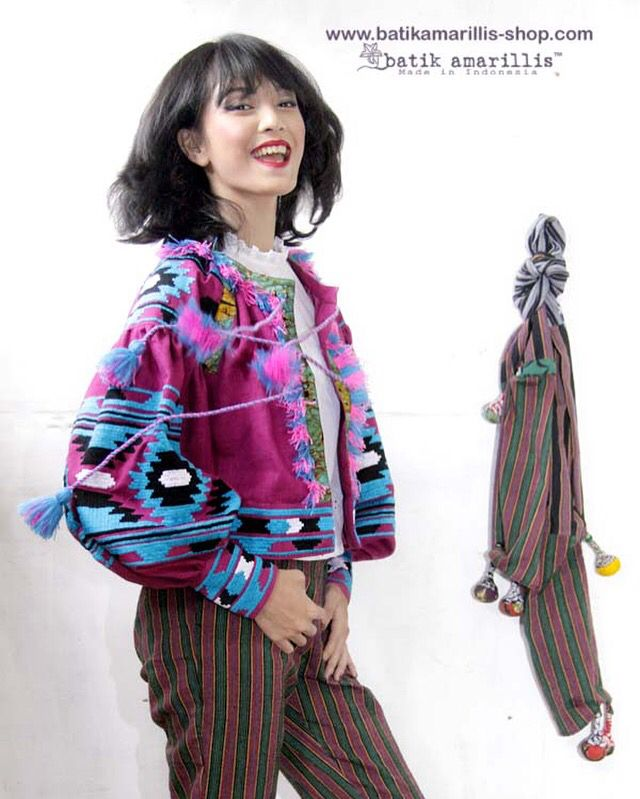 Batik Amarillis's Vasylysa jacket started availabe at Batik Amarillis webstore:www.batikamarillis-shop.com on August 12 Jacket,linen blend jacket which takes its cues from the traditional Ukrainian's costume known for its intricate embroidery & billowing silhouette. Cut for a loose fit, this comes with peasant-style details. Balloon sleeves are decorated with geometric Ukrainian embroidery stye also highlighted with Batik Wonogiren of Indonesia plus soft pom