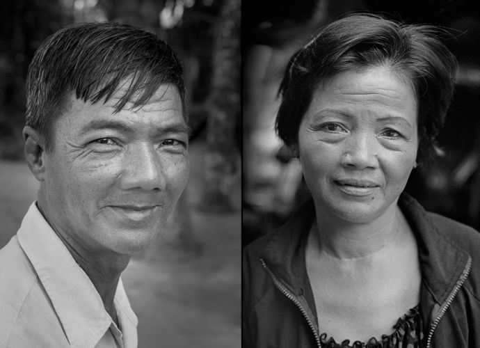 """Ho Van Bon and Ho Thi Ting, Kim Phuc's cousins, to the right of Kim Phuc in the famous Nick Ut """"napalm girl"""" photo, seen here in 2014 in Trang Bang."""