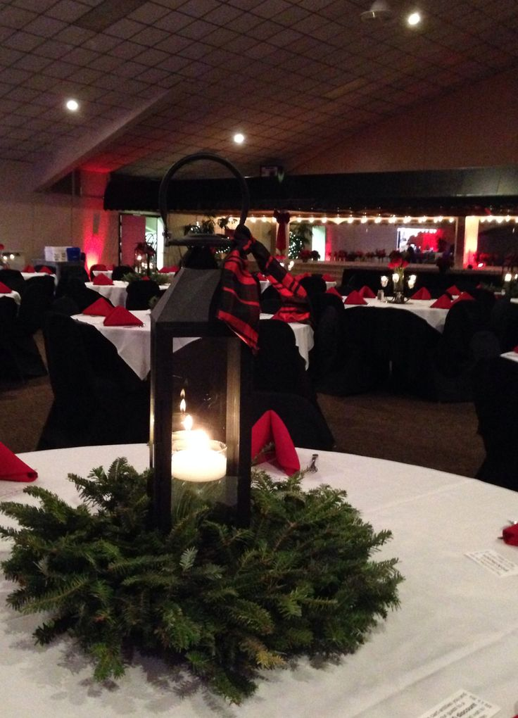 A Corporate Christmas Party Color Theme: Traditional Christmas Red with Black accents. Black Lanterns, Fresh Evergreen, Red Roses and Submerged White Pine (floating Candles) Red Accent Lighting…Red and Black Plaid Ribbon. Black Linens, White Overlays, Black Chair Covers, and Red Linen Napkins Design Exclusive, LLC www.designexclusivellc.com