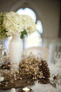 Love this simple centerpiece. get a couple vine wreathes to surround the centerpieces