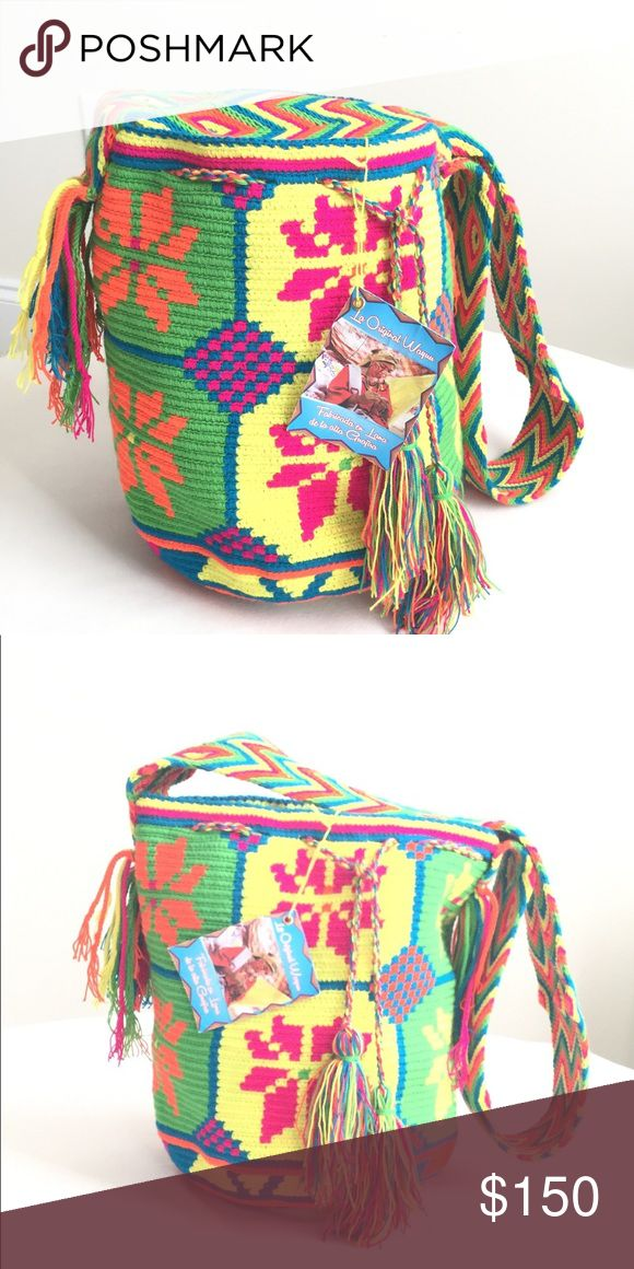 Wayu Mochila Bag The Wayuu mochila bag is brought to life by Wayuu women in the La Guajira peninsula in northern Colombia. This bag takes up to 15 days to weave by hand with just a single strand of thread, making a very tight and strong weave. The pattern is a symbol of the Wayuu culture and a fine example of their ethnic lifestyle.   > Support ethical clothing, handmade, eco clothing, fair trade clothing, wayuu craftsmanship and sustainable Wayuu Tribe Bags Crossbody Bags