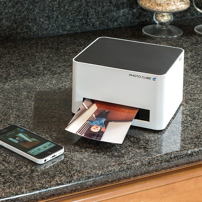 """This compact photo printer creates its own Wi-Fi network to connect with all iPhones, iPads, Samsung Galaxies and all other Android devices. Take it to parties for instant photo fun — it makes beautiful photos in three sizes: 4""""x6"""", 4""""x11.2"""" and 4""""x16.4"""". Print photos from any digital camera via PictBridge or USB cable. Uses mess-free cartridges that contain the paper and ink. Includes trial cartridge that makes 10 4""""x6"""" prints. Prints photos directly from digital cameras via ..."""
