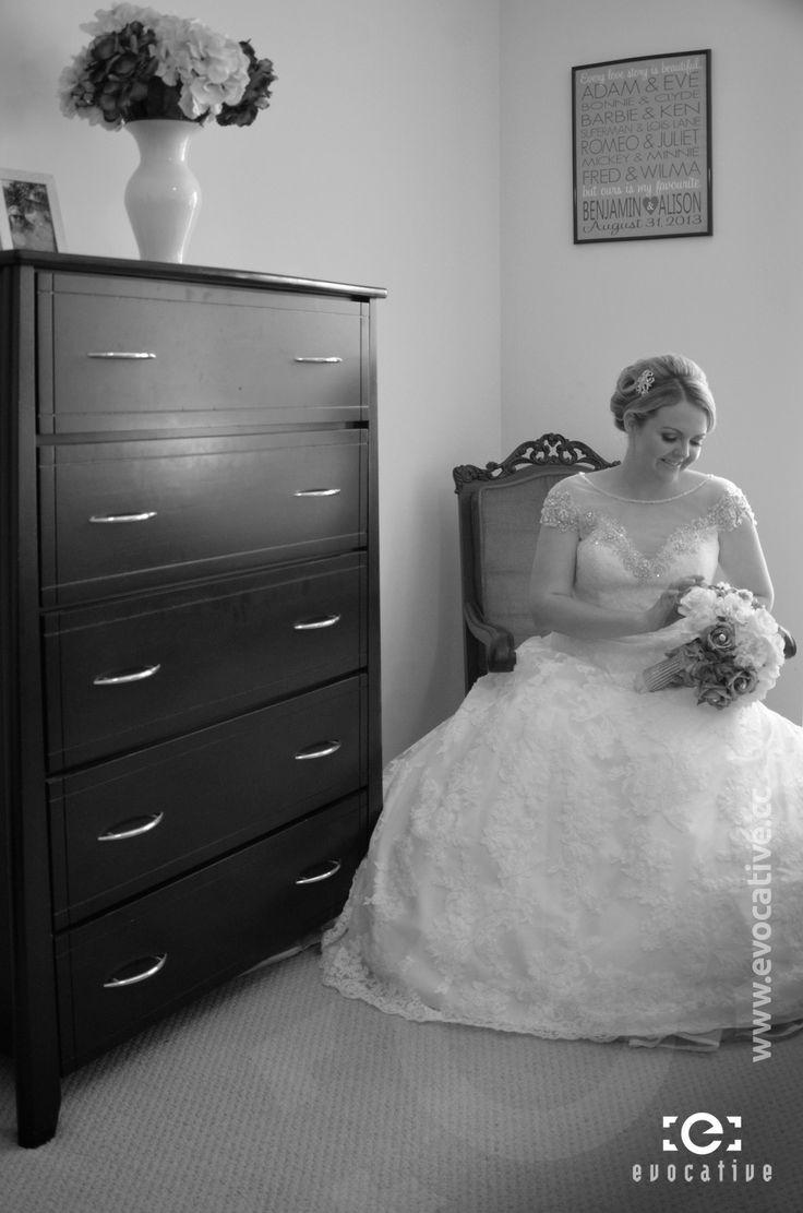 Portrait of the bride sitting on an ornate chair in her bedroom, thinking about the wonderful day that lies ahead. #WeddingPhotography