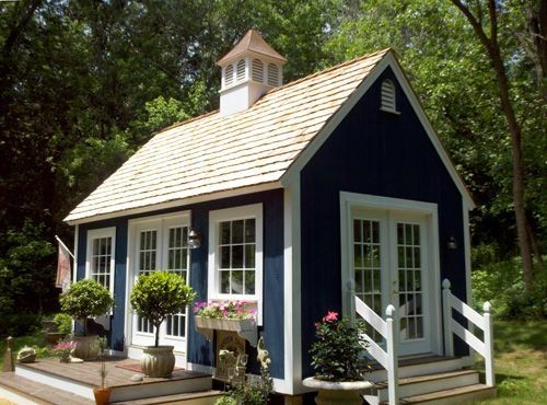 Tiny house with cupola and french doors. I love the tiny house in this picture.